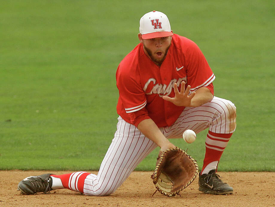 University of Houston first baseman Casey Grayson fields a ground ball in the second inning during an NCAA baseball game against Rice at Constellation Field on Tuesday, May 13, 2014, in Sugar Land. Photo: J. Patric Schneider, For The Chronicle / © 2014 Houston Chronicle