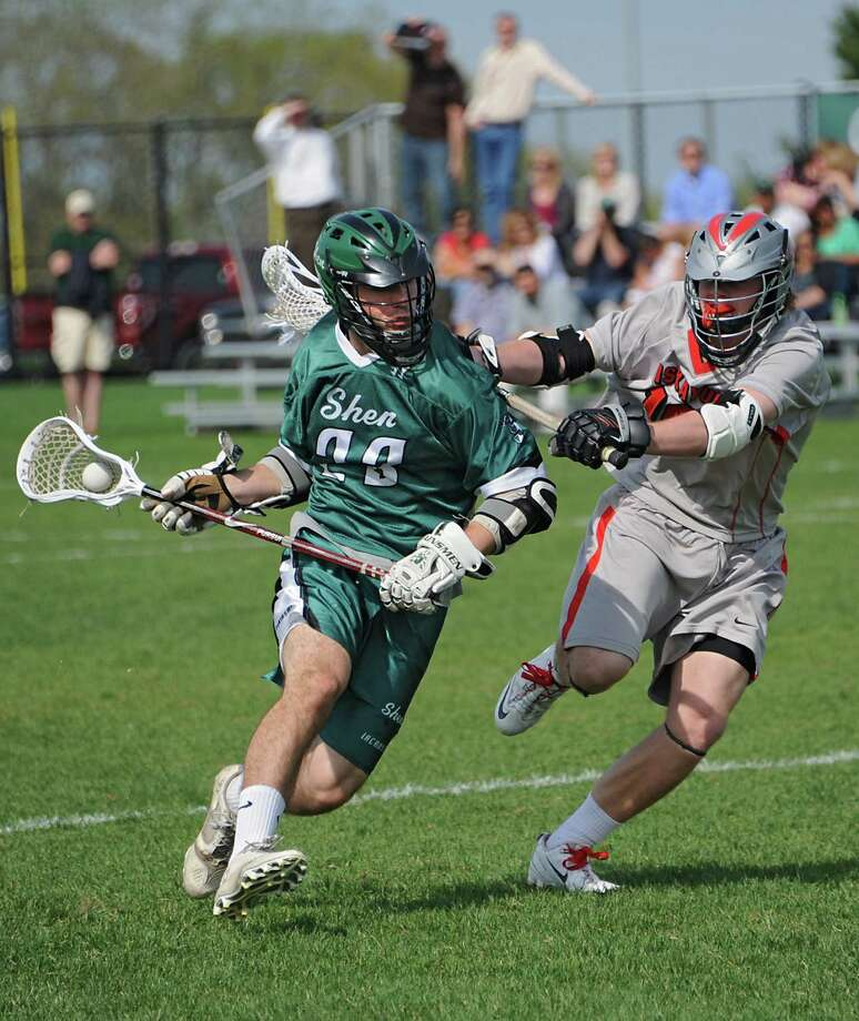 Shenendehowa's Mitch Turiel, left, is defended by  Niskayuna's Reed Avveduti during a lacrosse game Tuesday, May 13, 2014 in Niskayuna, N.Y.  (Lori Van Buren / Times Union) Photo: Lori Van Buren / 00026857A