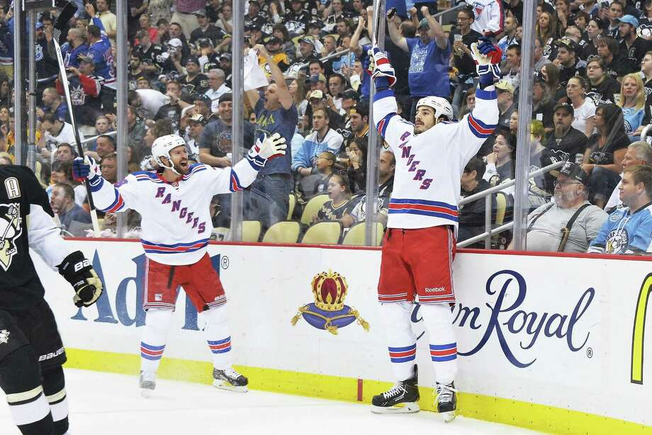 PITTSBURGH, PA - MAY 13:  Dominic Moore #28 of the New York Rangers, left, and Brian Boyle #22 of the New York Rangers celebrate after Boyle scored a goal against the Pittsburgh Penguins in the first period in Game Seven of the Second Round of the 2014 NHL Stanley Cup Playoffs on May 13, 2014 at CONSOL Energy Center in Pittsburgh, Pennsylvania.  (Photo by Jamie Sabau/Getty Images) ORG XMIT: 488087715 Photo: Jamie Sabau / 2014 Getty Images