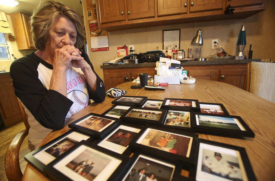 Carolyn Richardson contemplates photographs as she looks through mementos and documents relating to her husband, Anson Dale Richardson, who died suddenly Nov. 4 in an Austin hospital. Photo: TOM REEL