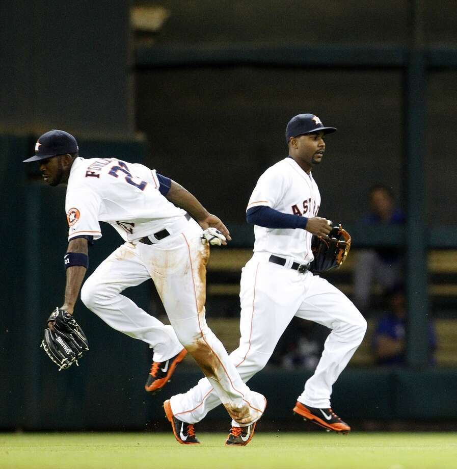 Astros center fielder Dexter Fowler makes a catch during the third inning. Photo: Karen Warren, Houston Chronicle