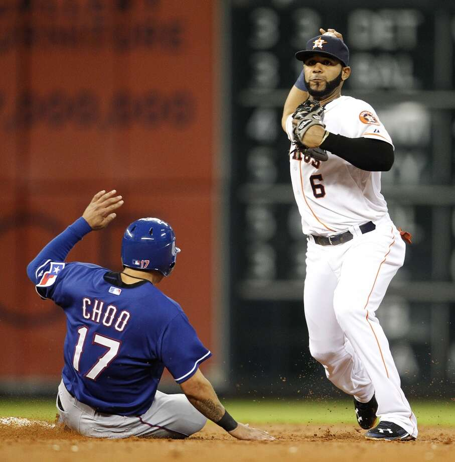 Shortstop Jonathan Villar turns a double play. Photo: Karen Warren, Houston Chronicle
