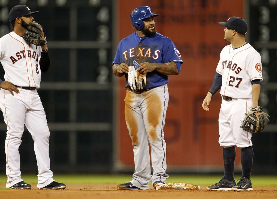 Svelte slugger Prince Fielder, center, of the Rangers chats with Astros infielders Jose Altuve, right, and Jonathan Villar. Photo: Karen Warren, Houston Chronicle