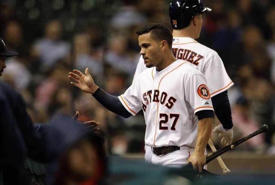 Second baseman Jose Altuve  celebrates after scoring a run. Photo: Karen Warren, Houston Chronicle