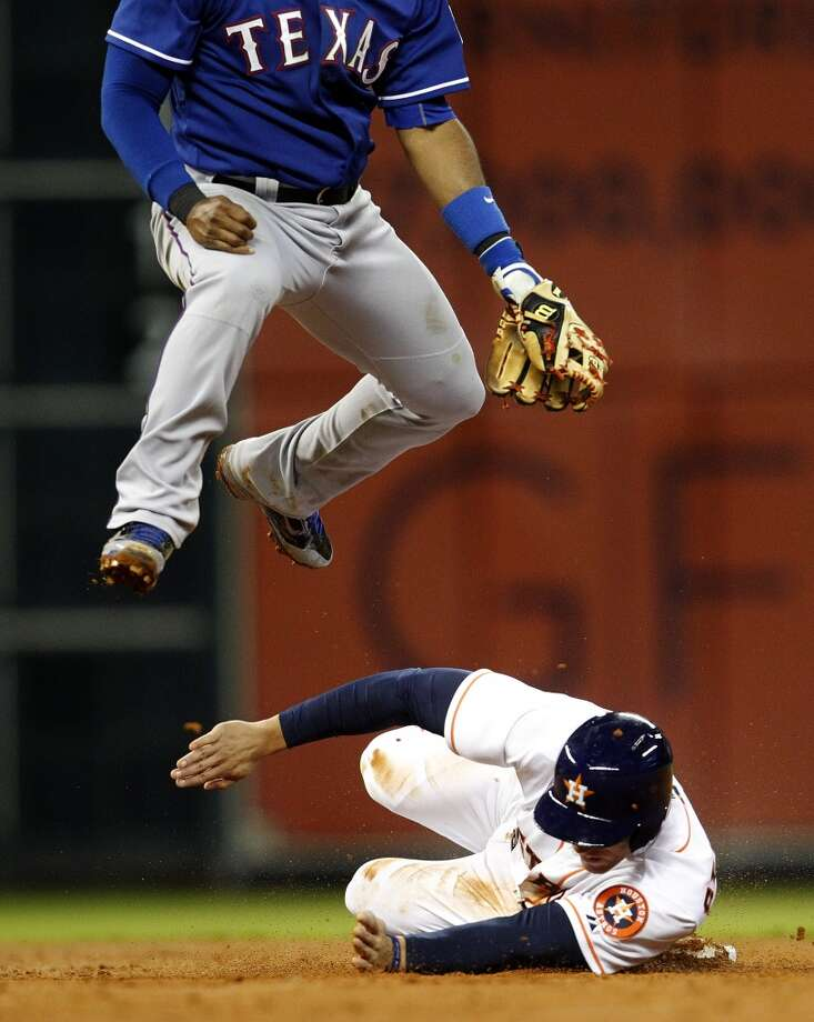 George Springer  is out on a force out by Rangers second baseman Rougned Odor. Photo: Karen Warren, Houston Chronicle