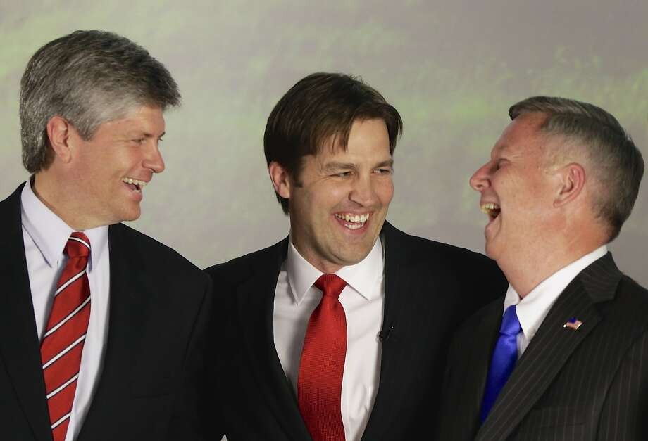 GOP Senate hopeful Ben Sasse (center) has a laugh with Rep. Jeff Fortenberry, R-Neb. (left), and Gov. Dave Heineman after his primary election victory. Photo: None, Associated Press