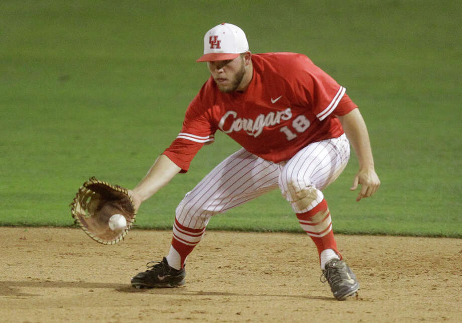University of Houston first baseman Casey Grayson fields the ball  during the ninth inning of an NCAA baseball game against Rice at Constellation Field on Tuesday, May 13, 2014, in Sugar Land. Photo: J. Patric Schneider, For The Chronicle / © 2014 Houston Chronicle