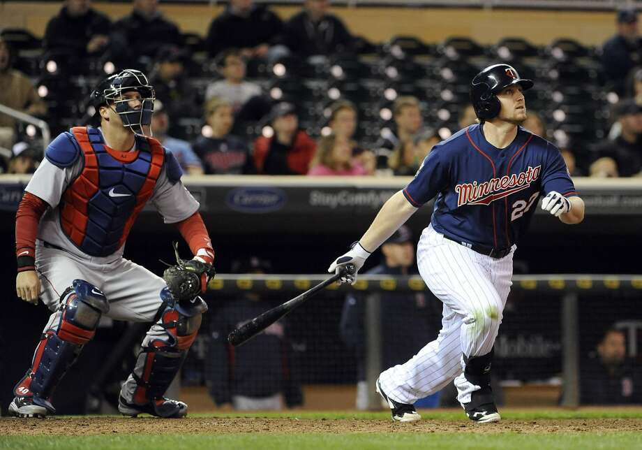 Minnesota Twins' Chris Parmelee watches his two-run home run in front of Boston Red Sox catcher A.J. Pierzynski during the ninth inning of a baseball game in Minneapolis, Tuesday, May, 13, 2014. The Twins won 8-6. (AP Photo/Craig Lassig) Photo: Craig Lassig, Associated Press
