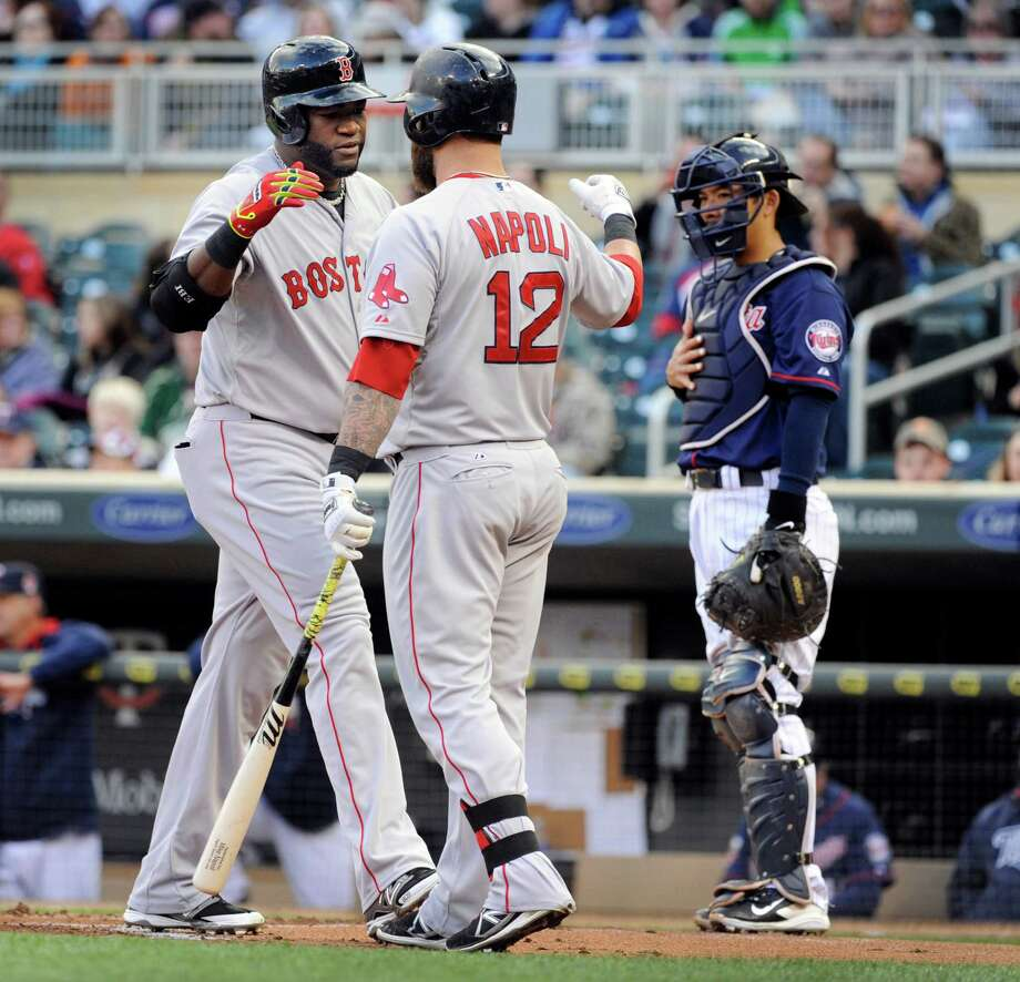 Boston Red Sox David Ortiz (34), left, celebrates with Mike Napoli (12), center, after hitting a solo home run against Minnesota Twins pitcher Ricky Nolasco as catcher Kurt Suzuki (8), right, looks on during the first inning of a baseball game in Minneapolis, Tuesday, May, 13, 2014.(AP Photo/Craig Lassig) ORG XMIT: MNCL104 Photo: CRAIG LASSIG / FR52664 AP