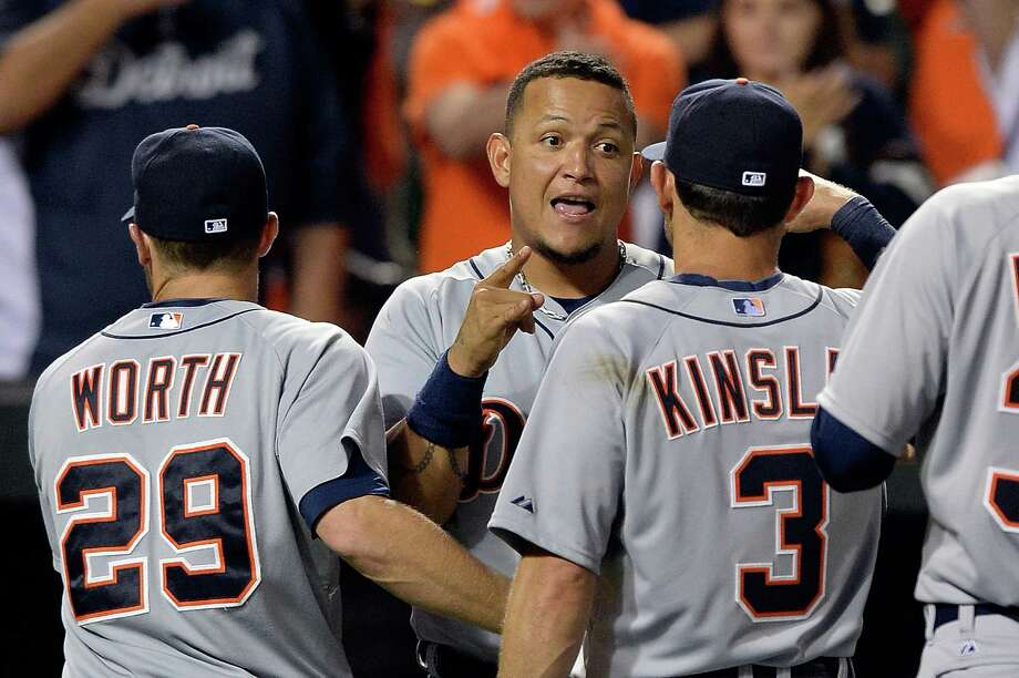 BALTIMORE, MD - MAY 13:  Miguel Cabrera #24 of the Detroit Tigers celebrates with Danny Worth #29 and Ian Kinsler #3 after the Tigers defeated the Baltimore Orioles 4-1 during a game at Oriole Park at Camden Yards on May 13, 2014 in Baltimore, Maryland. (Photo by Patrick McDermott/Getty Images) ORG XMIT: 477583137 Photo: Patrick McDermott / 2014 Getty Images