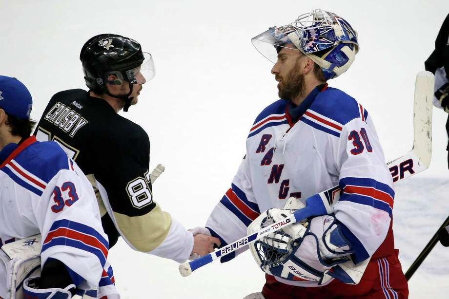 The headliners meet after Game 7 before going their separate ways, with the Penguins' Sidney Crosby, left, finished after scoring one goal in the playoffs and Henrik Lundqvist moving on after backstopping the Rangers' comeback from a 3-1 deficit. Photo: STF / AP