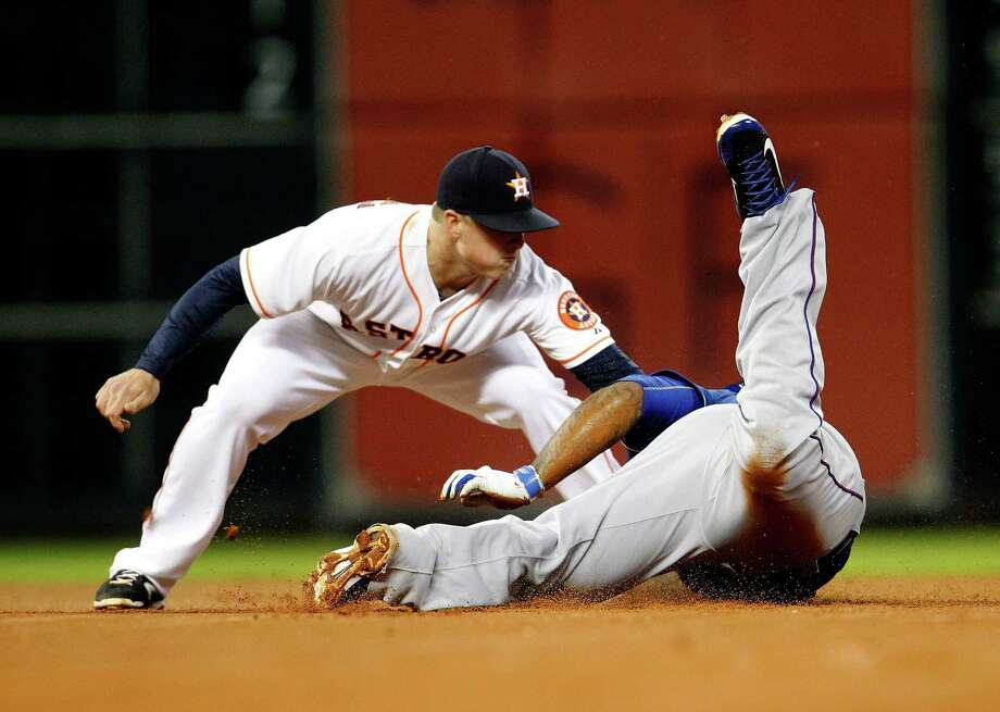A less than graceful slide into second base by the Rangers' Prince Fielder in the fourth inning sets up a replay review. The tag by Matt Dominguez was ruled to have been too late before being reversed. Photo: Karen Warren, Staff / © 2014 Houston Chronicle