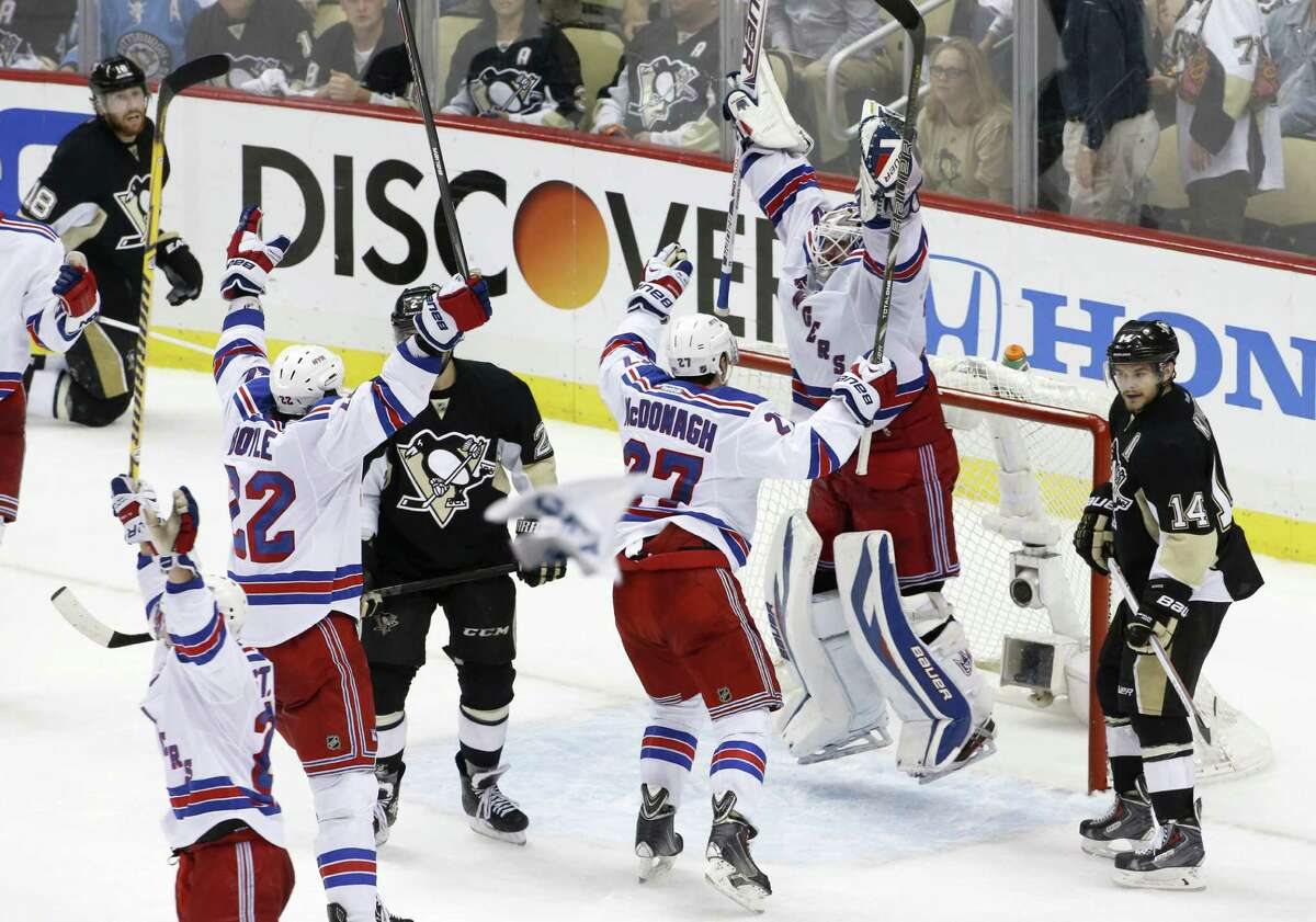 Rangers goalie Henrik Lundqvist rejoices with teammates after their 2-1 Game 7 victory in Pittsburgh in the Eastern semis.