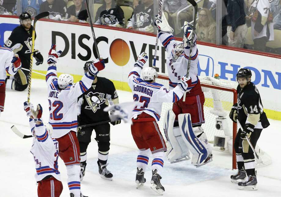 Rangers goalie Henrik Lundqvist rejoices with teammates after their 2-1 Game 7 victory in Pittsburgh in the Eastern semis. Photo: Associated Press / AP
