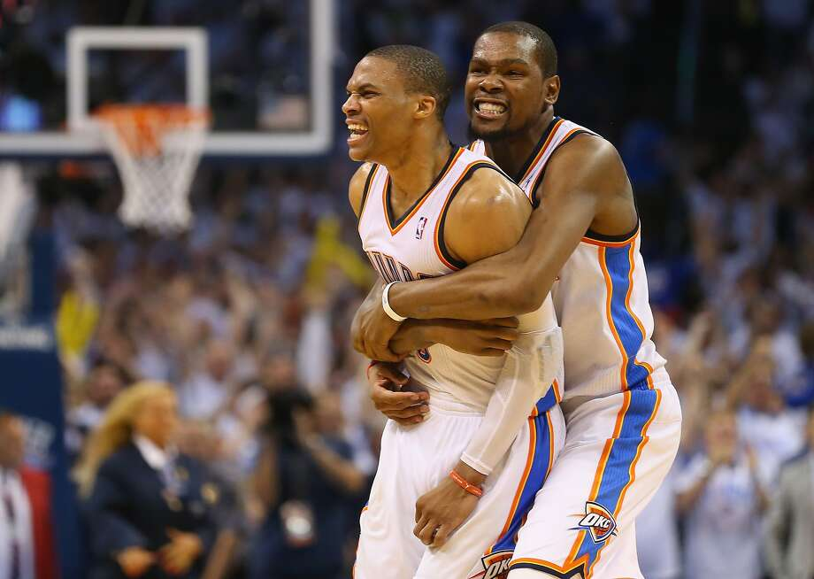 Oklahoma City's Kevin Durant (right) embraces Russell Westbrook after the Thunder pulled out the victory. Photo: Ronald Martinez, Getty Images