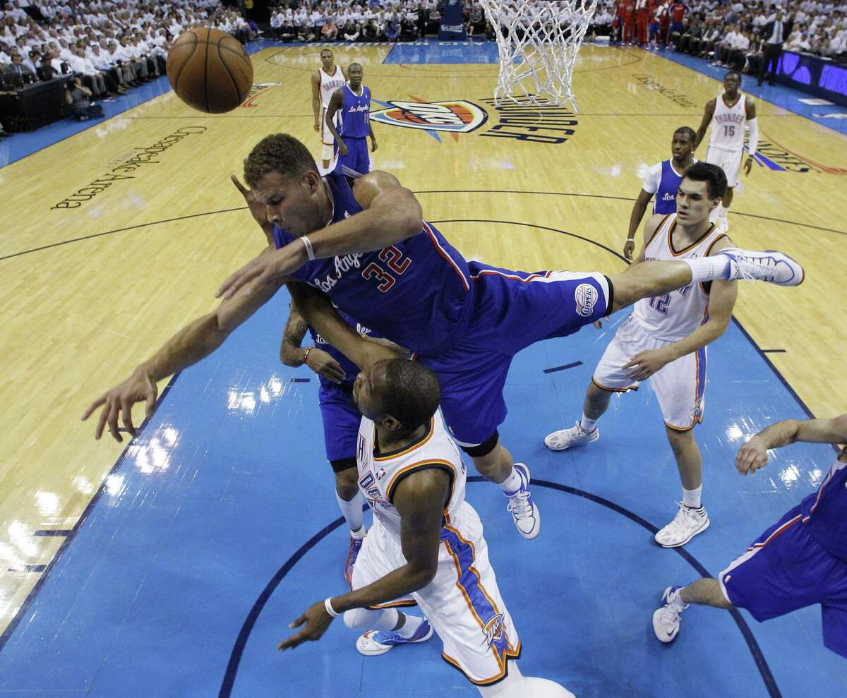 Thunder forward Kevin Durant, who finished with 27 points, 10 rebounds and five assists, is fouled by the Clippers' Blake Griffin (32) in the second quarter.