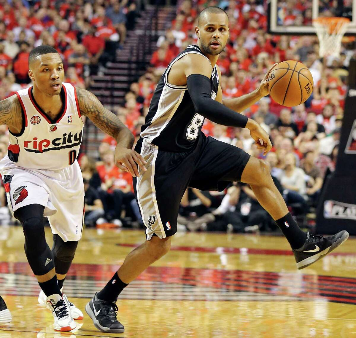 San Antonio Spurs' Patty Mills looks for room around Portland Trail Blazers' Damian Lillard during first half action of Game 4 in the Western Conference semifinals Monday May 12, 2014 at the Moda Center in Portland, OR.