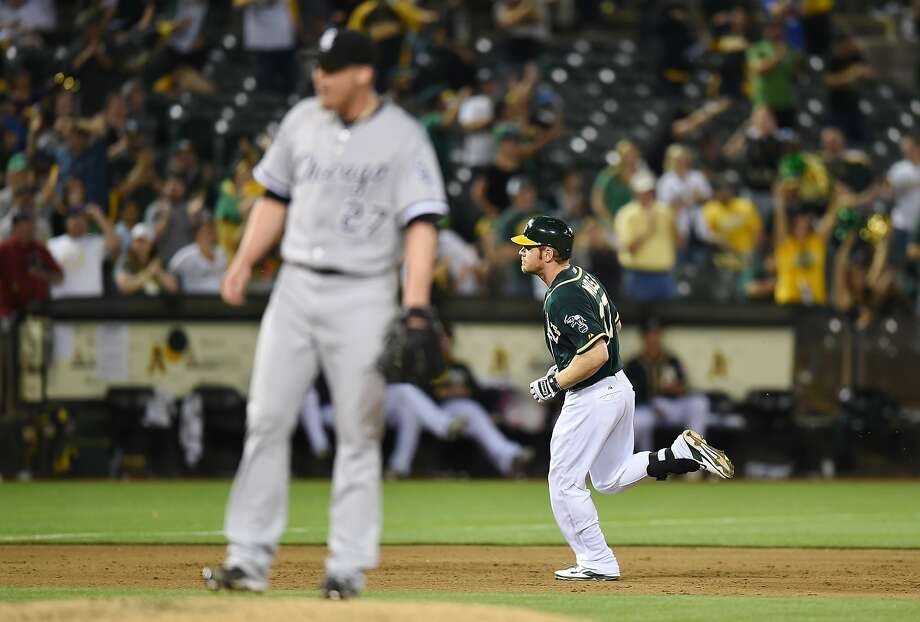 Brandon Moss circles the bases on his homer off Chicago's Matt Lindstrom. Photo: Thearon W. Henderson, Getty Images