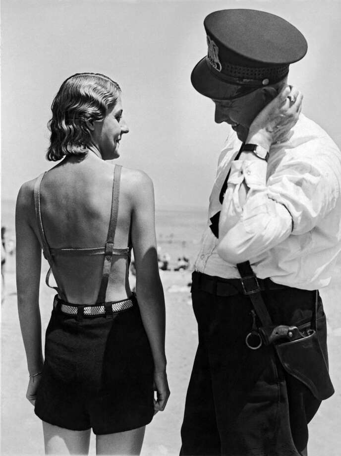 A policeman contemplates the latest in bathing suit fashion on the Chicago waterfront, circa 1927. Photo: Underwood Archives, Getty Images