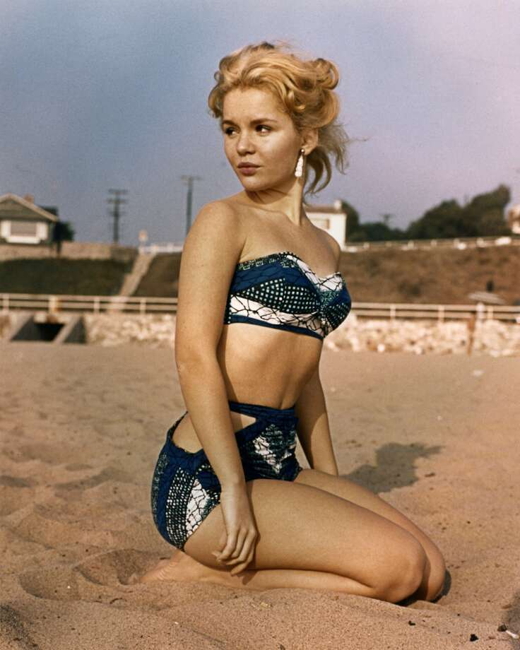 Tuesday Weld wears a dark blue bikini, circa 1960. Photo: Silver Screen Collection, Getty Images