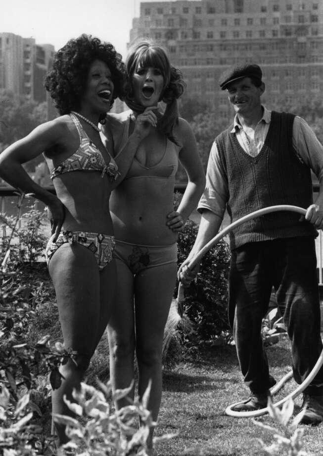 Two women modeling swimwear in a garden on London's South Bank, June 1973. Photo: Evening Standard, Getty Images