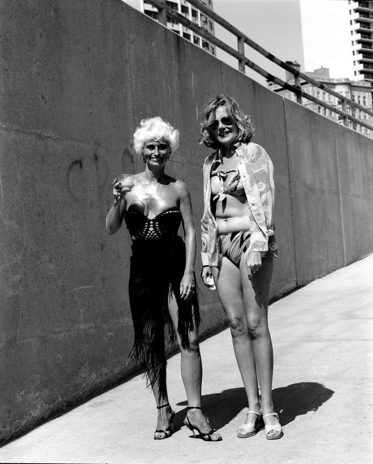 Two women wear fashionable swimsuits and are ready for the sun while standing on one of the ramps leading to the beach, Chicago, 1978. Photo: Robert Natkin, Getty Images