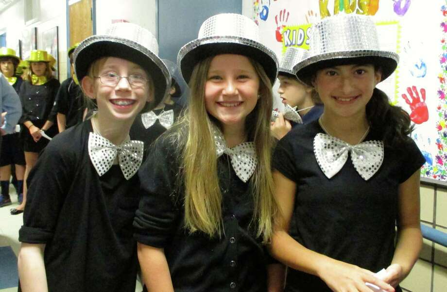 "Hindley School fifth-graders recently performed in ""The History of the Broadway Musical."" The songs included those from ""The Sound of Music,"" ""Hairspray"" and ""Les Miserables."" Charlotte Maher, Sophie Hermes and Logan Sibilio show off their Broadway costumes before the show. Photo: Contributed Photo, Contributed / Darien News"