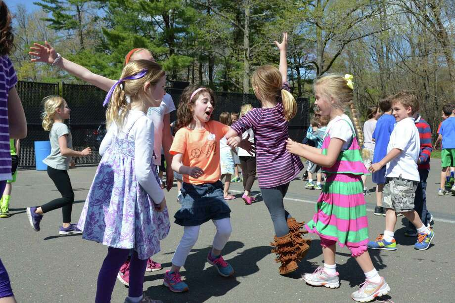 "The Tokeneke School Kids Care Club hosted a record-breaking fundraiser to benefit the Obie Harrington-Howes Foundation. There were 165 Tokeneke students, in kindergarten to grade 5, who attended the ""Groove-a-Thon"" and were challenged to keep moving for one hour straight. Some of the students do the ""chicken dance."" Photo: Contributed Photo, Contributed / Darien News"