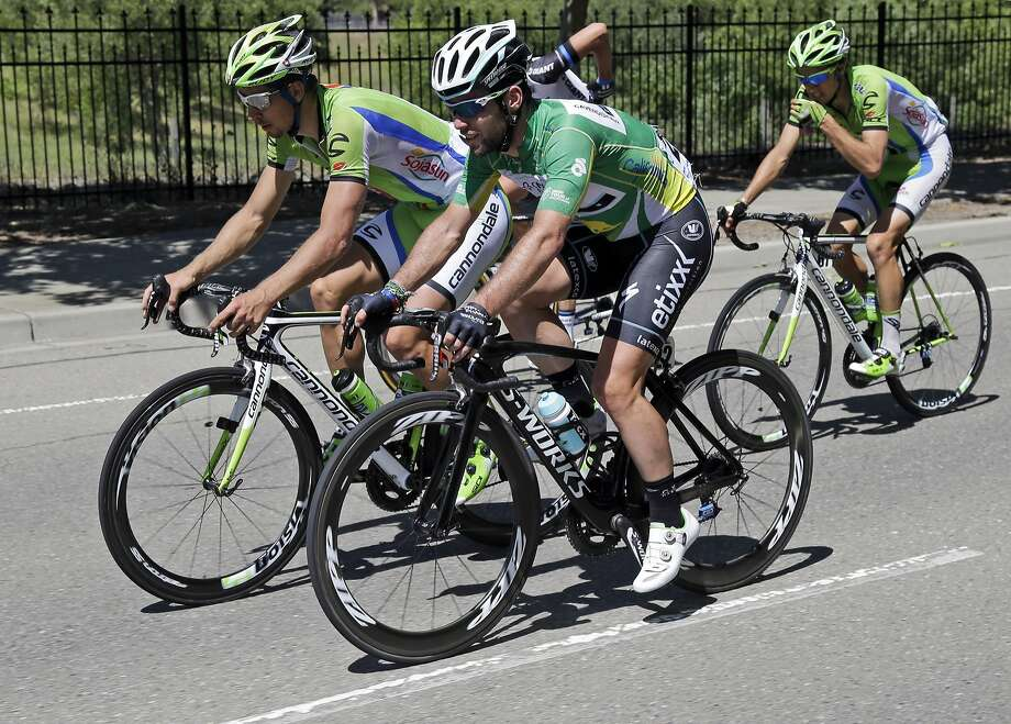 Peter Sagan, left, of Slovakia rides, left, rides to Mark Cavendish, center, of Great Britain, during stage 3 of the Tour of California cycling race on Tuesday, May 13, 2014, in Danville. Photo: Marcio Jose Sanchez, Associated Press