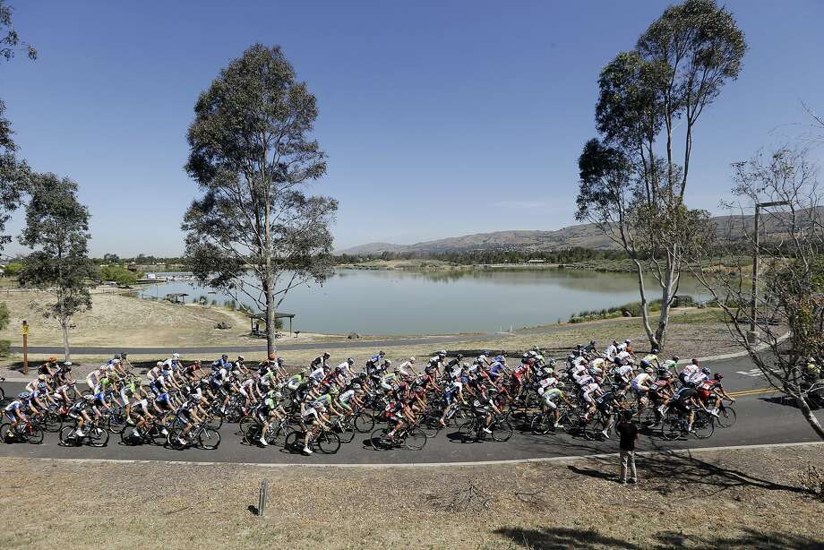 The peloton rides past Cunningham Lake during stage 3 of the Tour of California cycling race on Tuesday, May 13, 2014, in San Jose. Photo: Marcio Jose Sanchez, Associated Press