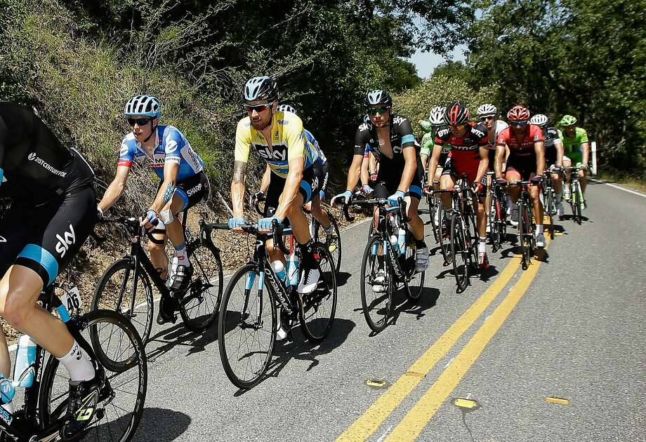 Stage winner Rohan Dennis (left) of Australia riding for Team Garmin-Sharp rides beside Sir Bradley Wiggins of Great Britain riding for Team Sky during stage three of the the 2014 Amgen Tour of California from San Jose to Mount Diablo on May 13, 2014 in San Jose. Photo: Ezra Shaw, Getty Images