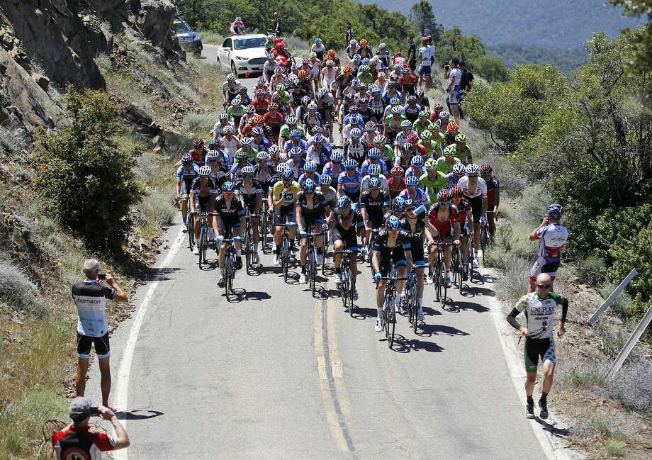Riders pedal between spectators on a mountain road during Stage 3 of the Tour of California cycling race, Tuesday, May 13, 2014, on Mount Hamilton in San Jose. Photo: Thomas Mendoza, Associated Press