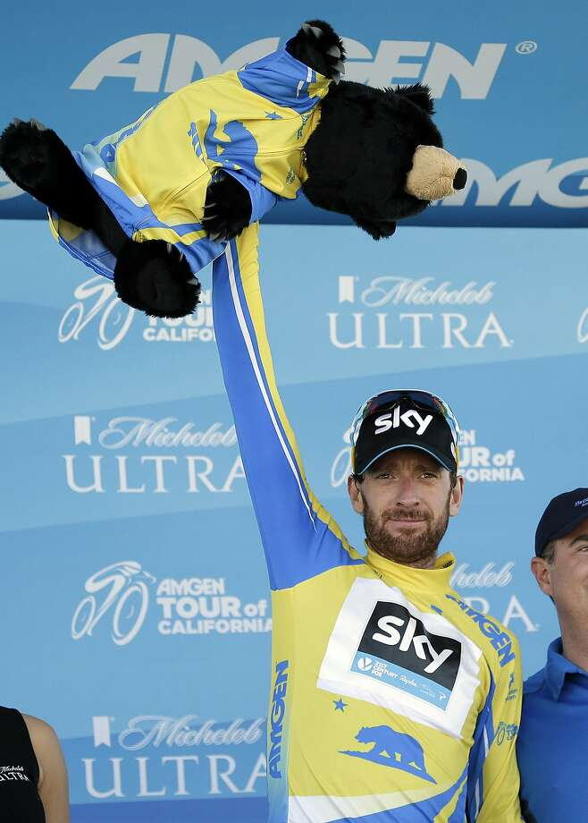 Britain's Bradley Wiggins celebrates on the podium after Stage 3 of the Tour of California cycling race on Tuesday, May 13, 2014, at Mount Diablo State Park in Clayton, Calif. Wiggins retained the overall lead in the race. Photo: Marcio Jose Sanchez, Associated Press