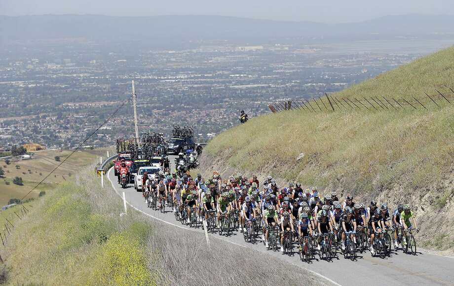 Riders head up to the top of Mt. Hamilton with the Silicon Valley as a backdrop during stage 3 of the Tour of California cycling race on Tuesday, May 13, 2014, in San Jose. Photo: Marcio Jose Sanchez, Associated Press