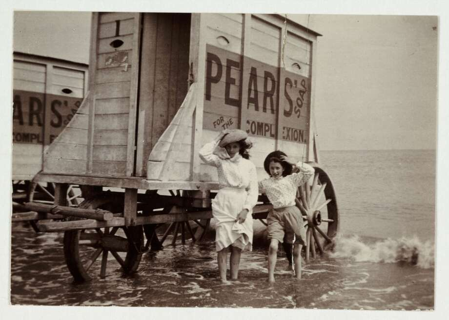A young woman and a girl standing beside a bathing machine at the seaside in about 1900. Bathing machines were designed to protect the modesty of bathers. Pulled to the edge of the sea by horses, they were moved according to the tides. Would-be bathers then could enter the machine at the back fully clothed and emerge in a swimming costume straight into the sea. Photo: Science & Society Picture Librar, SSPL Via Getty Images