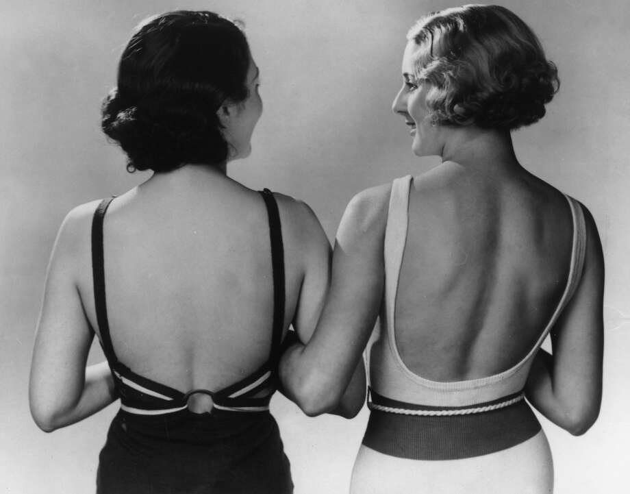 Low cut, square backs are the latest shape for knitted swimsuits in 1934. Photo: Fox Photos, Getty Images