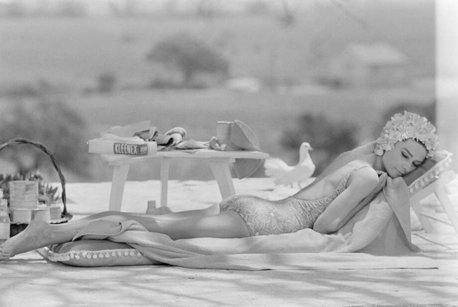 "Aactress Audrey Hepburn lounging by the pool  on location  in St Tropez during filming of ""Two For The Road,"" 1966. Photo: Terry O'Neill, Getty Images"
