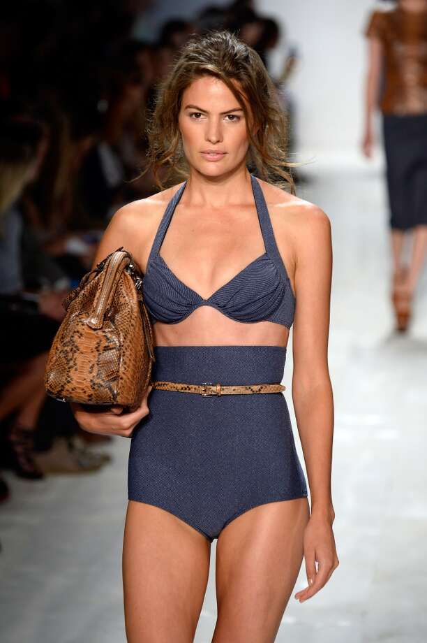 "A model walks the runway at the Michael Kors fashion show during Mercedes-Benz Fashion Week Spring 2014 showing off a contemporary ""retro"" bikini. Photo: Frazer Harrison, Getty Images For Michael Kors"