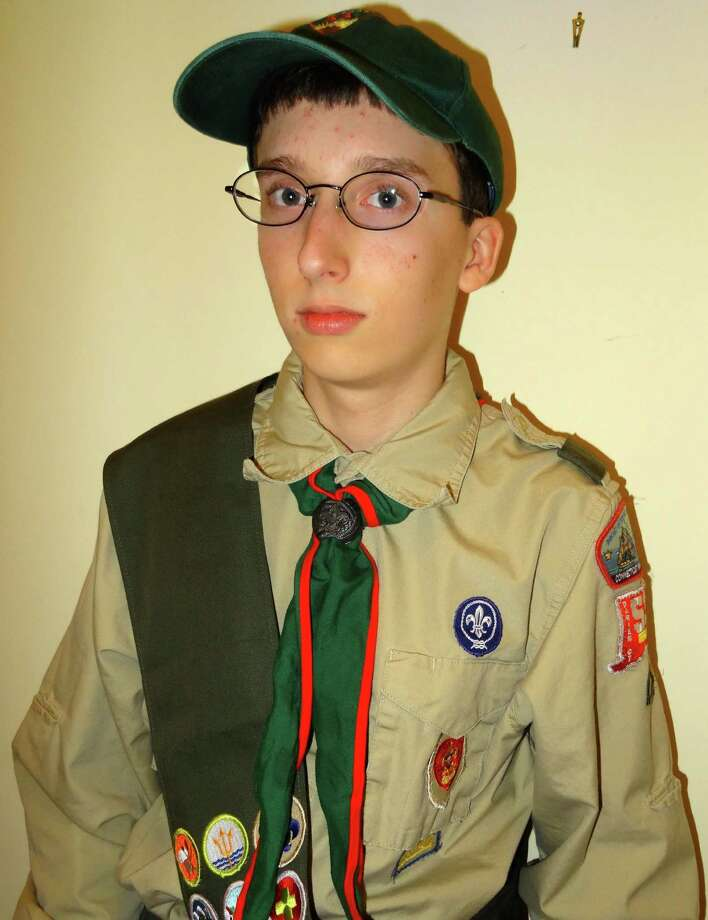 Alex Molwitz, 16, plans to install new bikes around town as part of his Eagle Scout project. Photo: Contributed Photo, Contributed / Darien News Contributed
