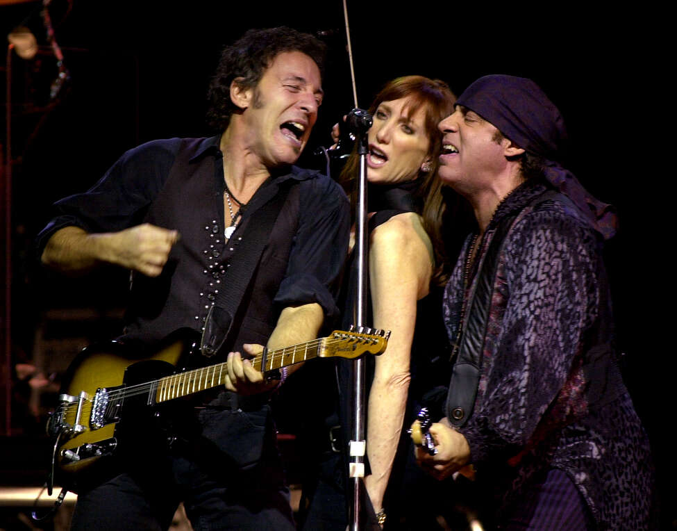 Times Union staff photo by Lori Kane -- Albany, NY -- Bruce Springsteen and the E Street Band play to a sold out crowd at the Pepsi Arena on Friday, December 13, 2002. From left, Bruce Springsteen, (Wife) Patti Scialfa and Steven Van Zandt.
