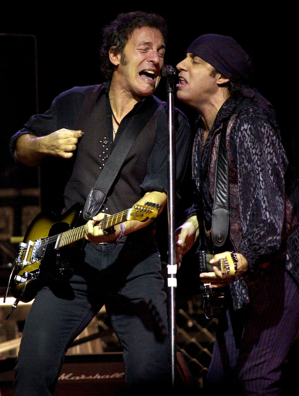 Times Union staff photo by Lori Kane Bruce Springsteen and Steven Van Zandt sing to a sold out crowd at the Pepsi Arena on Friday, December 13, 2002. Springsteen had his E Street band with him.