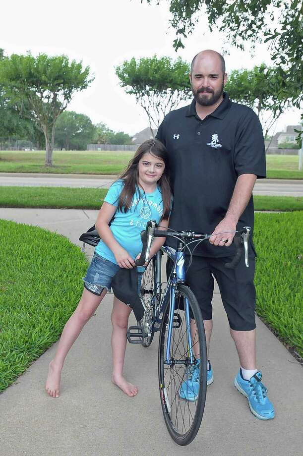 Eight-year-old Victoria Smelley will be on hand to cheer on her dad, Aaron Smelley, as he participates in the Soldier Ride, a national veterans' cycling event organized by the Wounded Warrior Project. Photo: Â Tony Bullard 2014, Freelance Photographer / © Tony Bullard & the Houston Chronicle