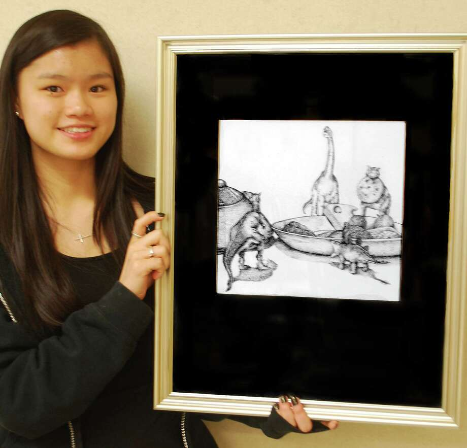 Staples High School student Moira Margolis won both âÄúGrand PrizeâÄù and âÄúBest in ShowâÄù in the district Congressional Art Award contest for her ink drawing of a humorous scene of dinosaurs feasting at a breakfast table. Photo: Contributed Photo / Westport News