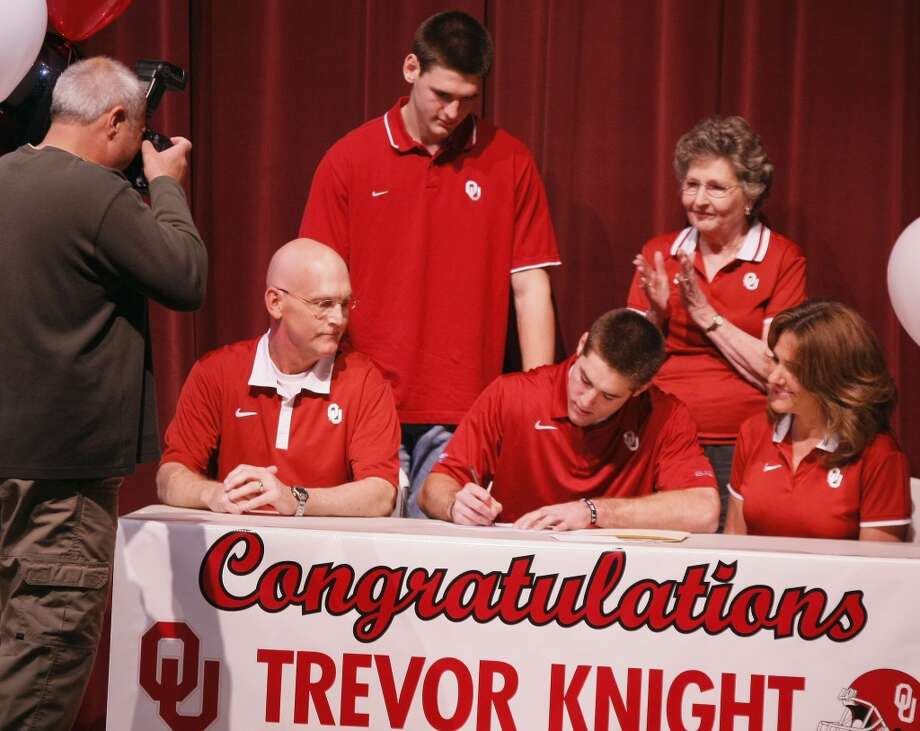 Reagan High School student Trevor Knight, center, signs a letter of intent to attend Oklahoma University, Wednesday, Feb. 1, 2012, at Reagan High School in San Antonio. (Darren Abate/Special to the Express-News) Photo: Darren Abate/Special To The Expr