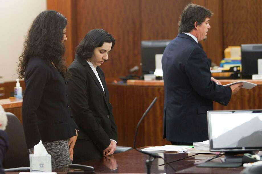 Narjes Modarresi, 32, stands in the courtroom for the opening of her trial at the Harris County Courthouse Wednesday, May 14, 2014, in Houston. Modarresi is charged with capital murder, accused of killing her 2-month-old son by burying him alive near Buffalo Bayou in west Houston in 2010. Photo: Brett Coomer, Houston Chronicle / © 2014 Houston Chronicle