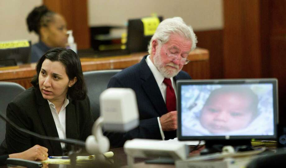 Narjes Modarresi, 32, left, sits with her attorney George Parnham during opening of her trial at the Harris County Courthouse Wednesday, May 14, 2014, in Houston. Modarresi is charged with capital murder, accused of killing her 2-month-old son by burying him alive near Buffalo Bayou in west Houston in 2010. Photo: Brett Coomer, Houston Chronicle / © 2014 Houston Chronicle