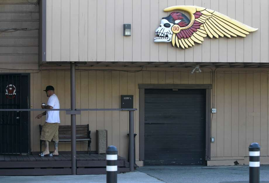 An unidentified man enters the Hell's Angels clubhouse after a pre-dawn raid by FBI agents in San Francisco, Calif. on Wednesday, May 14, 2014. Photo: Paul Chinn, The Chronicle