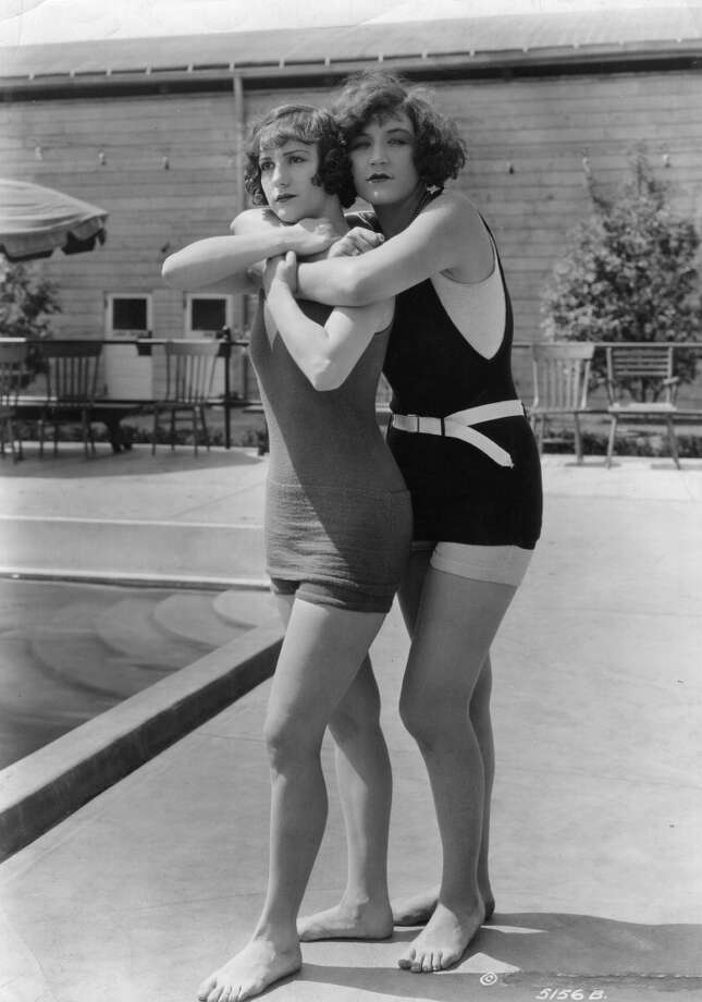 "Andrea Sayley and Margaret Oliver, two of slapstick comedian Mack Sennett's ""Bathing Beauties,"" demonstrate how to save someone from drowning, circa 1917. Photo: Hulton Archive, Getty Images"