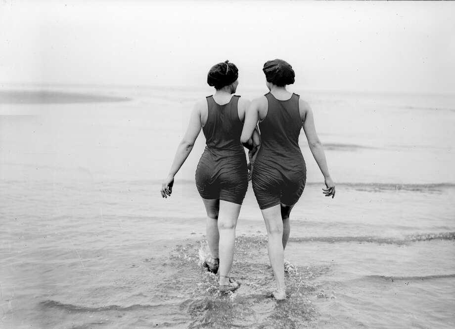 Swimmers walk into the water, about 1920. Photo: ND, Roger Viollet/Getty Images