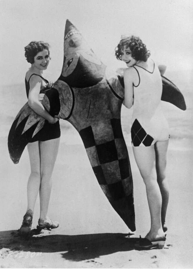 Two women in swimming costumes with a toy shark on the beach in Miami, Florida, August, 1929. Photo: Keystone-France, Gamma-Keystone Via Getty Images